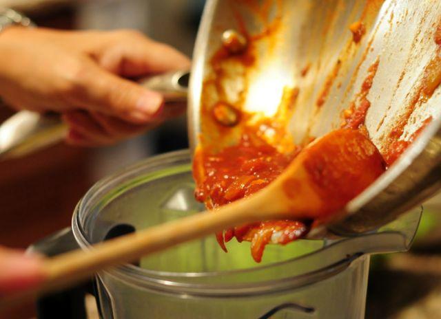 Noelle Pouring ketchecue Sauce